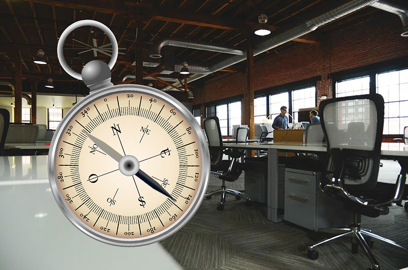 compass placed over photo of office