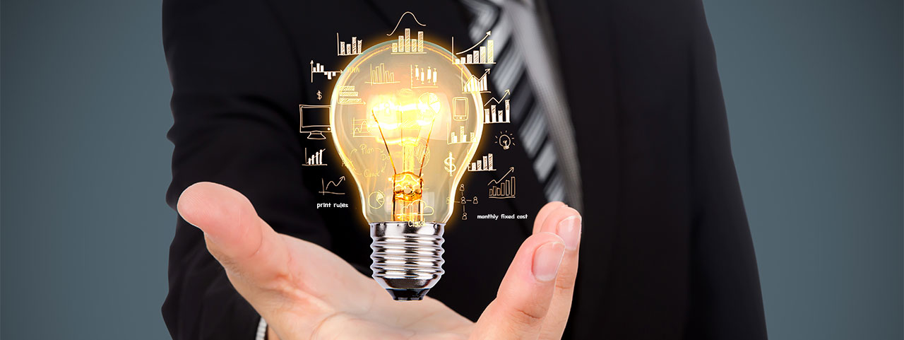 photo concept man holding lightbulb with graphs