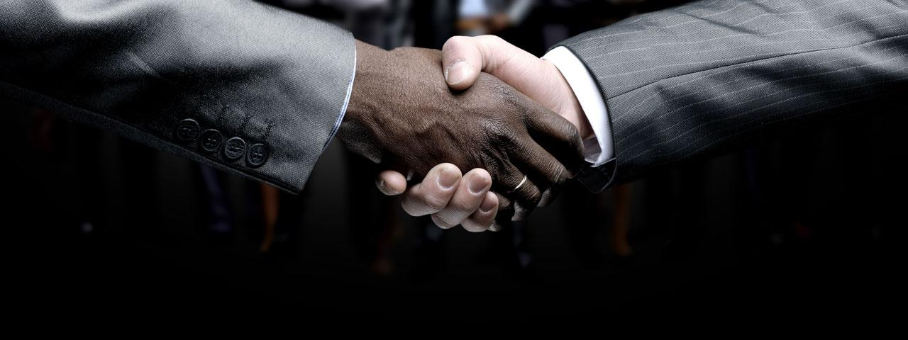 2 businessmen shaking hands