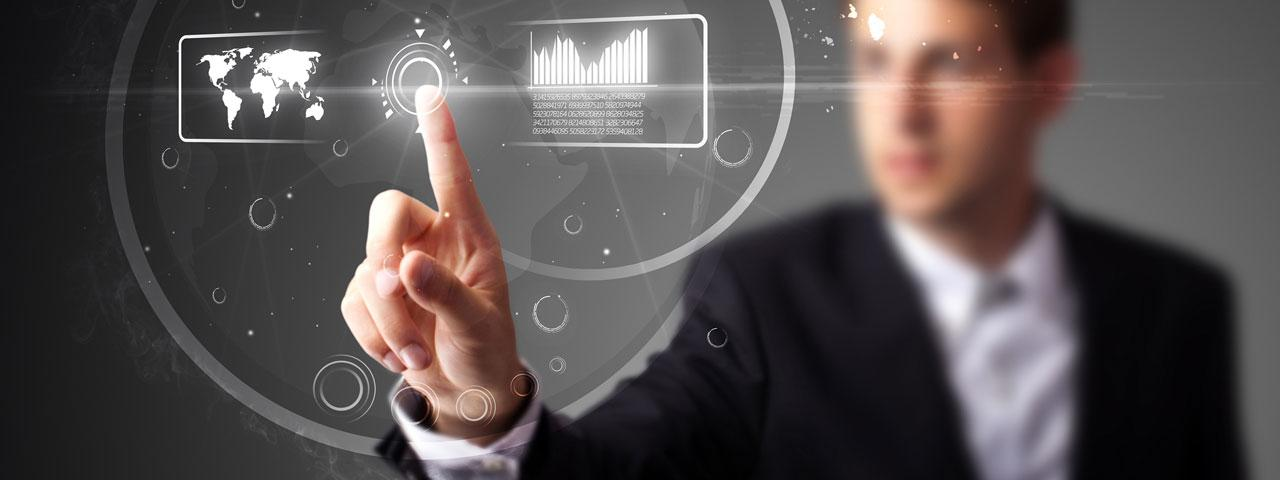 IT technology expert standing at a transparent interactive screen board